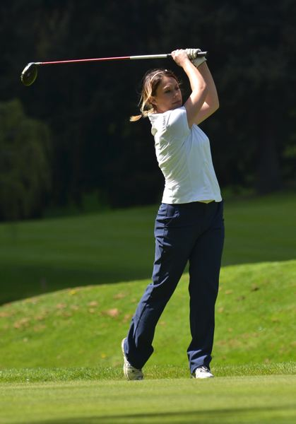 by: VERN UYETAKE - Lake Oswego's Alexa Huewe eyes a shot in Monday's tournament at Oswego Lake Country Club.