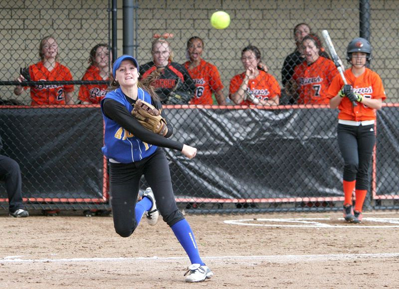 by: MILES VANCE - WING IT - Aloha senior third baseman Katie Newton makes a throw to first base during her team's 10-0 Metro League win over Beaverton at Beaverton High School on April 11.