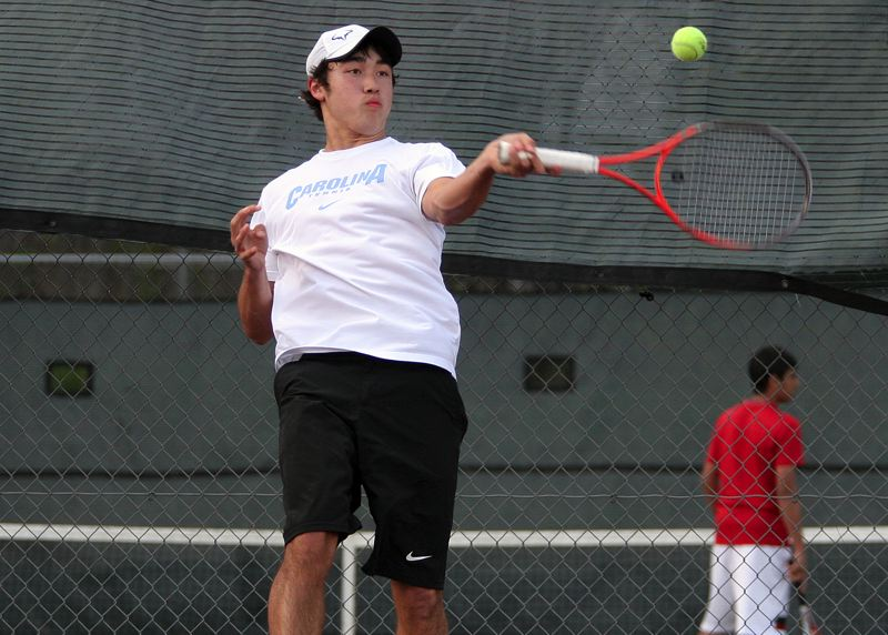 by: MILES VANCE - STEP UP - Southridge junior Andy Nakajima gets up to make a shot in his first singles win over Avi Vemuri on Monday.