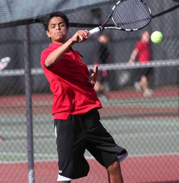 by: MILES VANCE - BIG FOREHAND - Westview sophomore Avi Vemuri makes a return in his first singles match loss to Southridge's Andy Nakajima on Monday afternoon at Westview High School.
