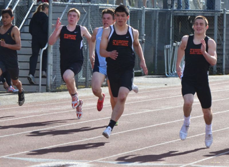 by: JOHN BREWINGTON - Scappoose's Paul Revis (right) and freshman Jarrett White were 1-2 in the 100-meter dash on Saturday at the Lower Columbia Invitational. Scappoose showed speed in the sprints and in the long jump where Justice Oman and Revis finished first and second.