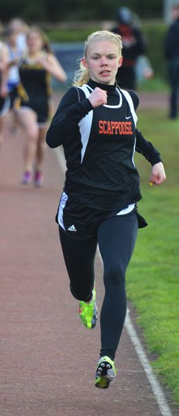 by: JOHN BREWINGTON - Scappoose's Charlie Davidson ran away from the field in the 800 at the Lower Columbia Invitational on Saturday. She also won the 400 in a meet with Banks last week.