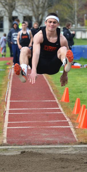 by: JOHN BREWINGTON - Scappoose's Paul Revis may be in his first year of track, but the senior is already very close to a new school record in the long jump. He went 22-feet, 1-inch against Banks, just four inches short of tying the record.