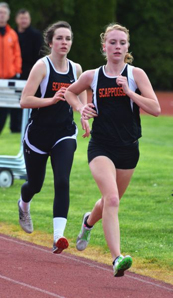 by: JOHN BREWINGTON - Scappoose's Tia Carnahan and Abby Kessi went 1-2 in the 1,500 at their meet with Banks.