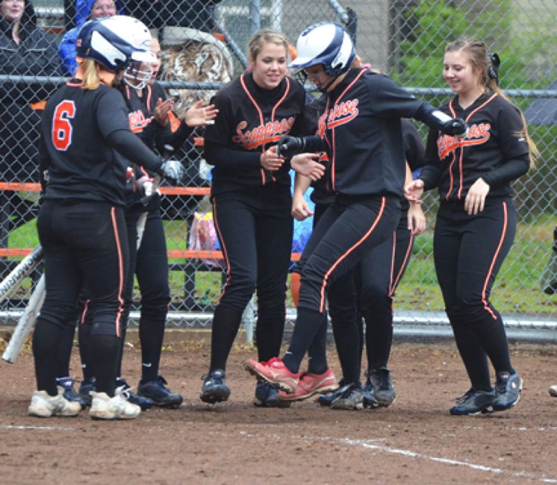 by: JOHN BREWINGTON - Scappoose's Cassidy Hoglund jumps for the plate after hitting a home run against Banks last Friday.