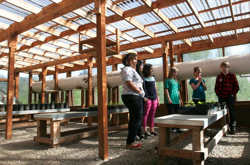 by: OUTLOOK PHOTO: JIM CLARK - Pleasant Valley Elementary Schools greenhouse allows students to start young trees that will be planted later in the green space.