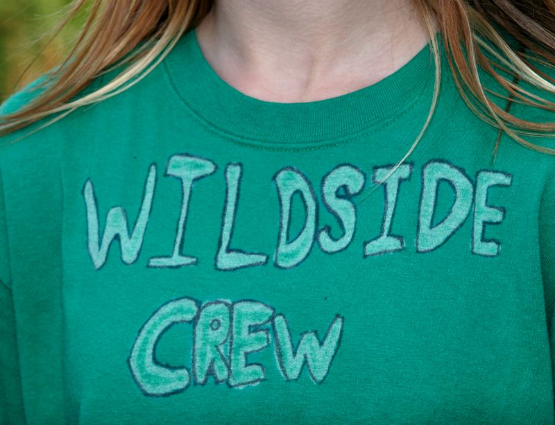 by: OUTLOOK PHOTO: JIM CLARK - Students have their own Wildside Crew t-shirts.