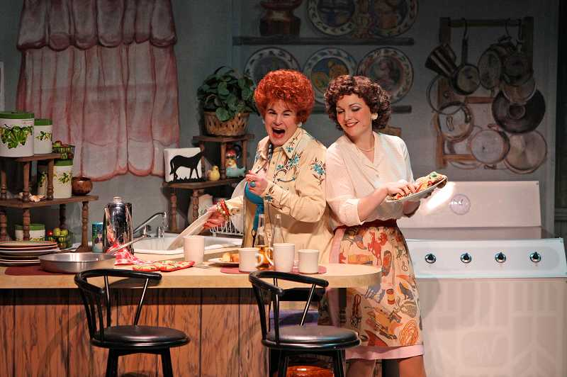 by: SUBMITTED PHOTO: CRAIG MITCHELLDYER - In a scene from the 2009 Broadway Rose production of 'Always... Patsy Cline,' Sharon Maroney as Louise Seger (left) and Sara Catherine Wheatley as Patsy Cline sing up a storm while cooking dinner in Seger's kitchen.