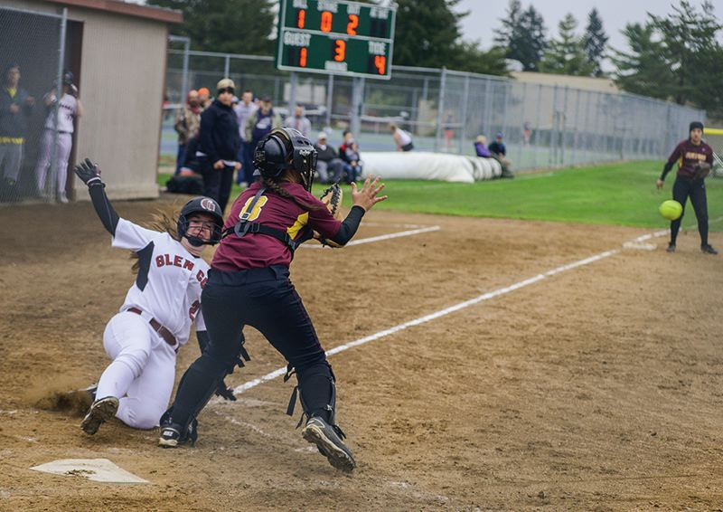 by: HILLSBORO TRIBUNE PHOTO: CHASE ALLGOOD - Glencoe freshman Emily Stonier slides safely into home plate ahead of the tag from Forest Grove catcher Leena Silvis during last Friday's Pacific Conference game.