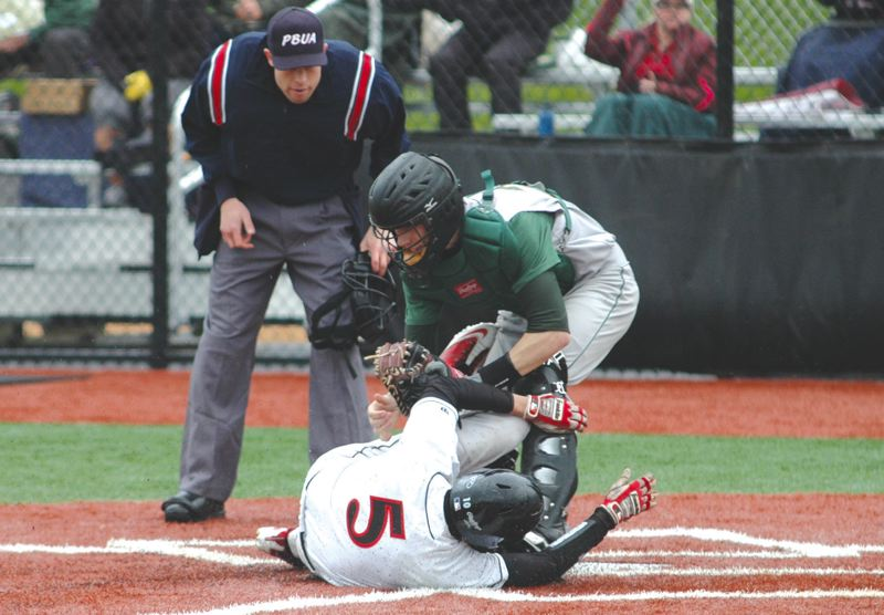 by: THE POST: PARKER LEE - Sandys Rhett Schilperoort slides onto the scene at home plate looking to add a run to the scoreboard Friday.