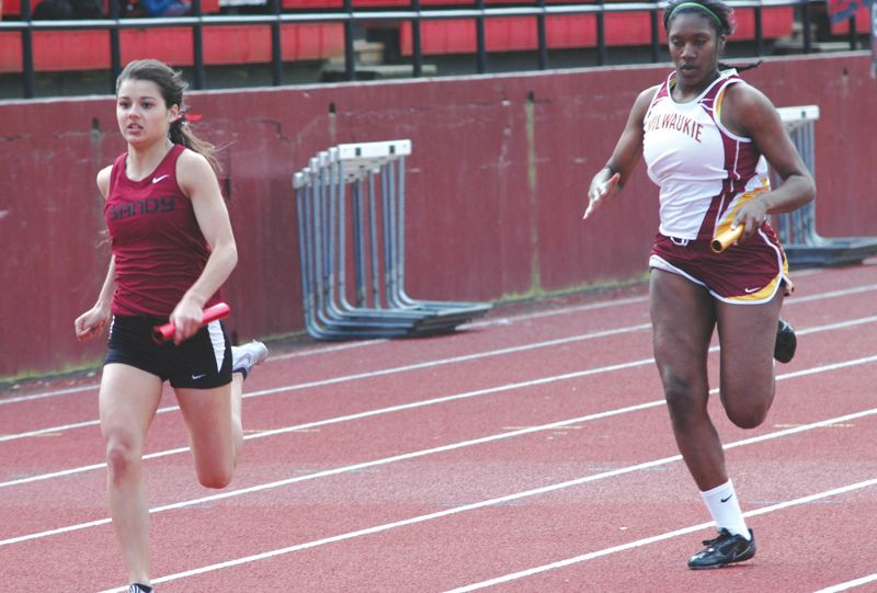 by: THE POST: PARKER LEE - Sandys Zayna Salveter holds off Milwaukies Cordaja Ware at the finish line in the 400-meter relay.