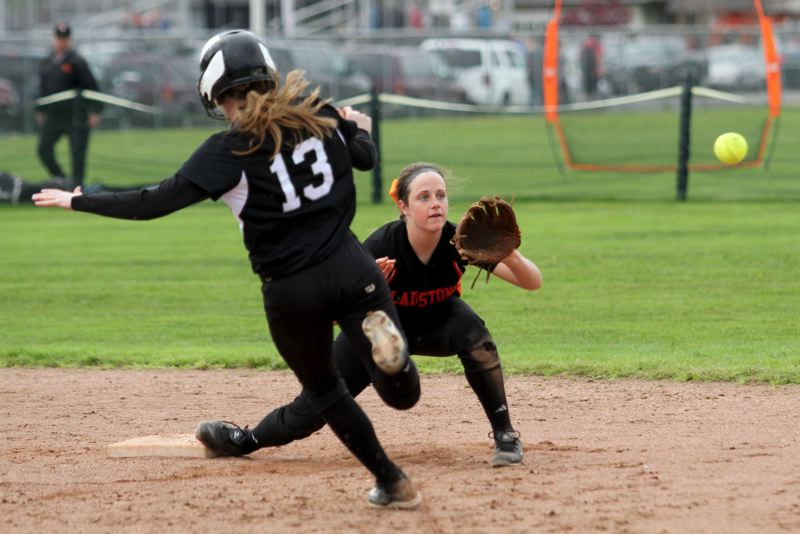 by: JONATHAN HOUSE - Nena Dudley gets the force out at second in Gladstones 10-1 rout of Estacada. Dudley starred on the mound in last weeks 7-1 win over Molalla, striking out 14 in a no-hitter.