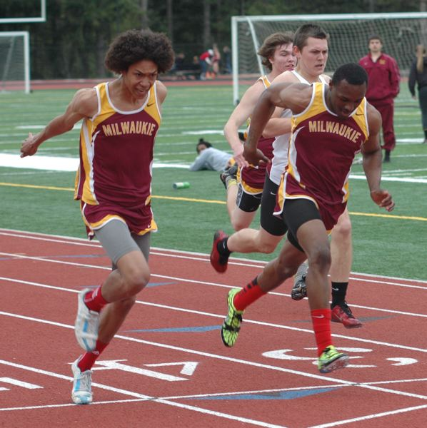 by: PHOTO BY PARKER LEE - Milwaukie seniors Dominique Meade (left) and Richard Ramsey went one-two in the 100-meter dash in last weeks meet at Sandy, but a disqualification in the sprint relay cost Milwaukie the meet.