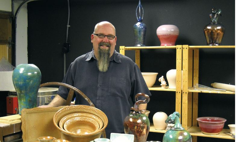 by: SUBMITTED PHOTO - Oregon City's Michael Moulet II displays some of his colorful ceramic pieces, fitting in with the ceramic showcases theme of Celebrating All Things Food.