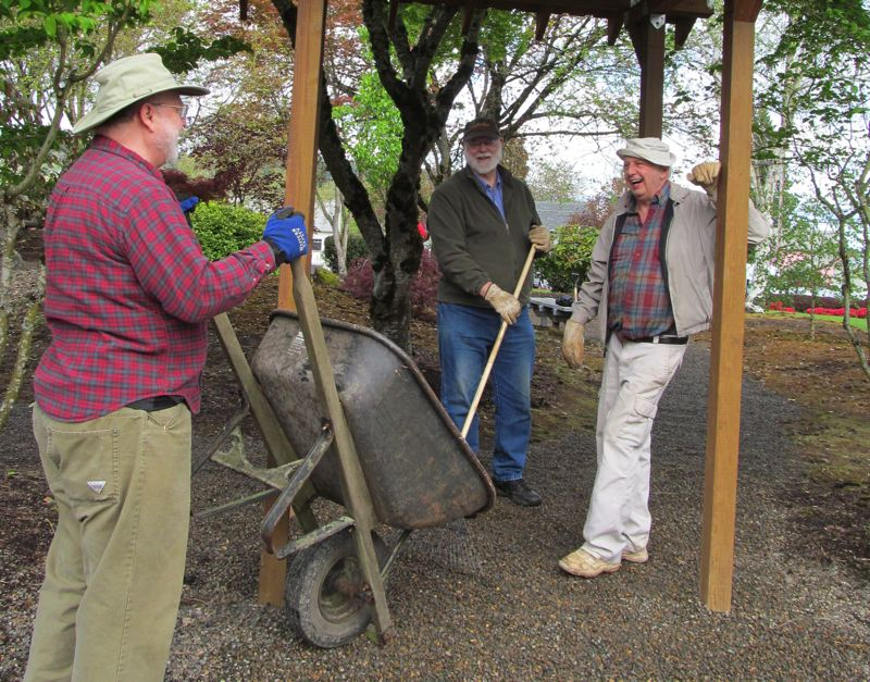 by: PHOTO BY ELLEN SPITALERI - Supporters of the Oregon City Tateshina Sister City Committee share a laugh while tidying up the Peace Garden near the Pioneer Community Center.