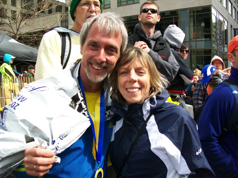 by: COURTESY: RALPH MCAFEE - Ralph McAfee was one of four Gresham residents who ran in the Boston Marathon on Monday, April 15, when terrorists detonated two bombs at the finish line. This photo of McAfee and his wife LeeAnne shows them at the finish line moments before the explosions.