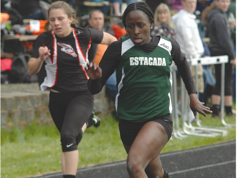 by: ESTACADA NEWS: PARKER LEE - Genna Settle hits the finish line first by a wide margin in the 200-meter race Thursday.