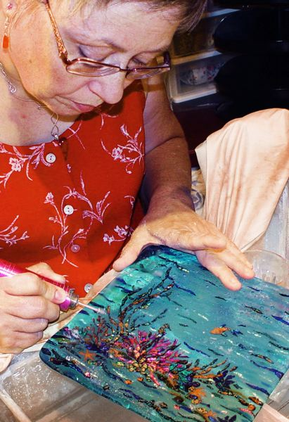 by: CONTRIBUTED PHOTO - Artist Shawna Hovey of Southeast Portland composes an ocean scene for her glass art collection on display this weekend at the Oregon Convention Center's Gathering of the Guilds.