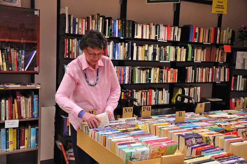 by: SUBMITTED PHOTO - Friends of the West Linn Library member Elsie Lewis works in the Book Cellar.