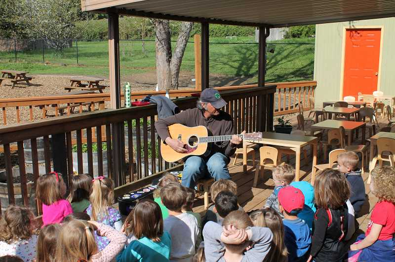 by: TIDINGS PHOTO: PATRICK MALEE - Rob Selvaggio plays a song during his visit to Heart Centered Montessori last week.