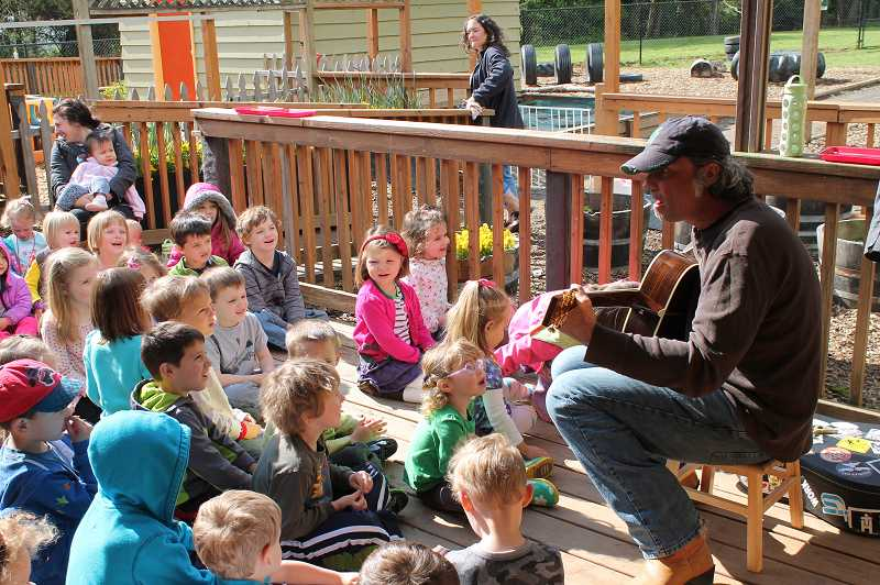 by: TIDINGS PHOTO: PATRICK MALEE - Rob Selvaggio engages with the children about the concept of love in between songs.