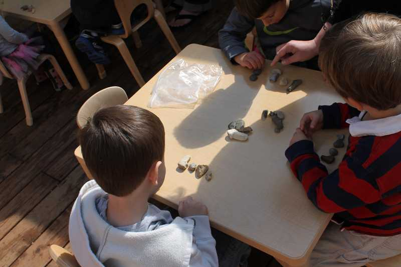by: TIDINGS PHOTO: PATRICK MALEE - Students admire their finished love rocks, which singer-songwriter Rob Selvaggio taught them how to make.