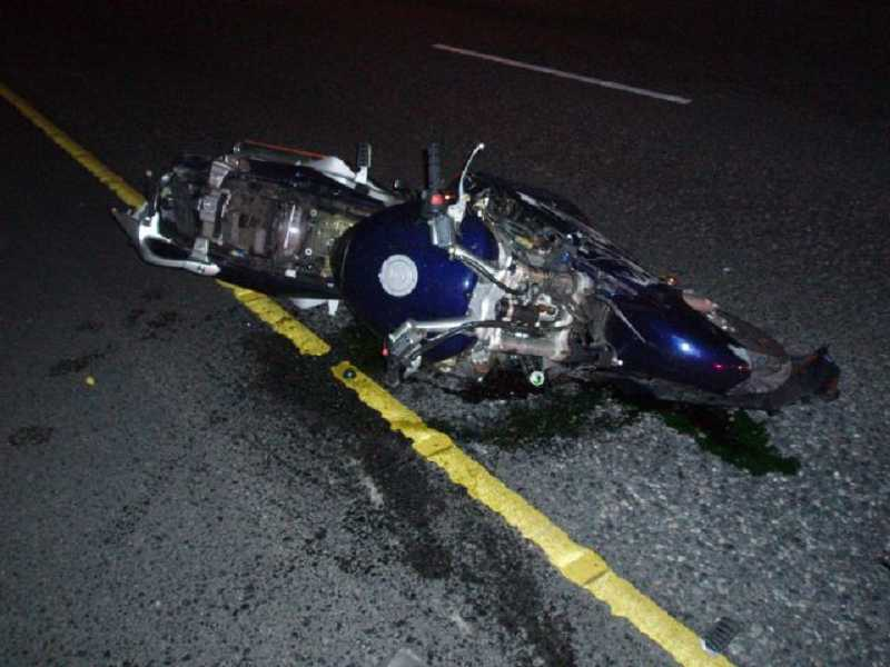 by: OREGON STATE POLICE - The motorcycle in the aftermath of Wednesday morning's crash.
