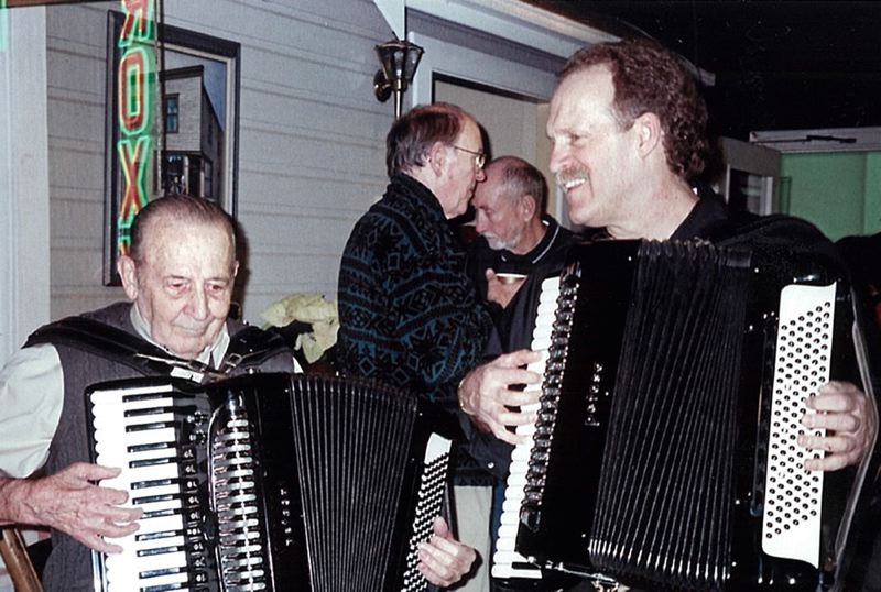 by: COURTESY PHOTO - COURTESY PHOTO John Giuliani (right) will watch for tapping feet when he squeezes the box at Sunday's Accordion Social in Forest Grove.