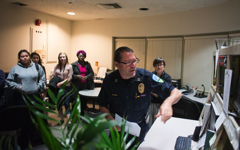 by: NEWS-TIMES PHOTO: CHASE ALLGOOD - Police Capt.  Mike Herb gives Citizens Academy students an inside tour of the Forest Grove Police Department in one of the last classes of the nine-week course.