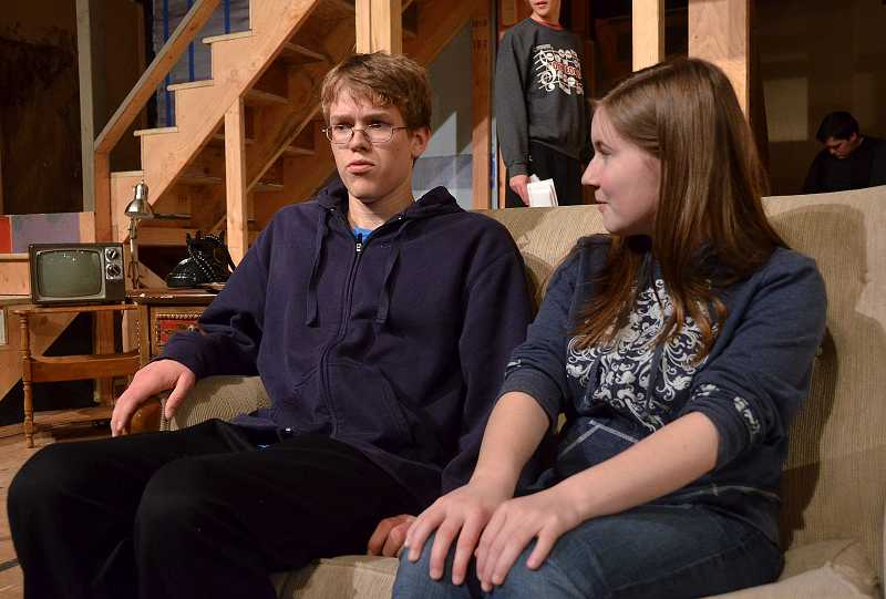 by: REVIEW PHOTO: VERN UYETAKE - Nathan Longacre as Selson and Rachel Munaw as Kim rehearse a scene.