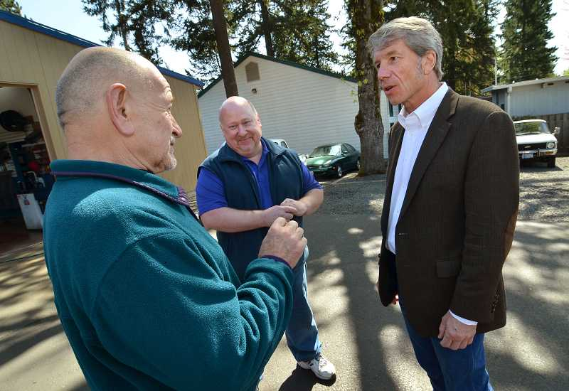 by: REVIEW PHOTO: VERN UYETAKE - U.S. Rep. Kurt Schrader, right, gets the lowdown on Lake Oswego business at Vic's Auto Center from Vic Keeler, left, and his brother Michael.