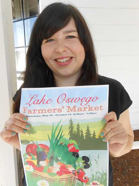 by: REVIEW PHOTO: CLIFF NEWELL - Jamie Inglis has many duties as the new manager of the Lake Oswego Farmers Market, including putting up as many posters as she can.