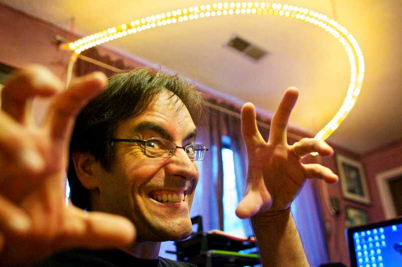 by: TIMES PHOTO: JAIME VALDEZ - Tigard's Edward Martin III plays to the camera at his home in Tigard. He will have two short films presented at the H. P. Lovecraft Film Festival in Portland next week. Martin has presented several films at the festival over the years, including his first animated feature film in 2003.