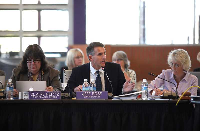 by: TIMES PHOTO: JONATHAN HOUSE - Beaverton School District Superintendent Jeff Rose discusses three funding scenarios during a Budget Committee meeting at Sunset High Scool on Monday.