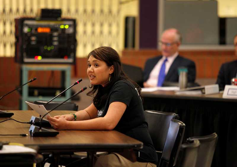 by: TIMES PHOTO: JONATHAN HOUSE - Aloha High School counselor Jen Townsley testifies during a Beaverton School District Budget Committee meeting against further staff cuts.
