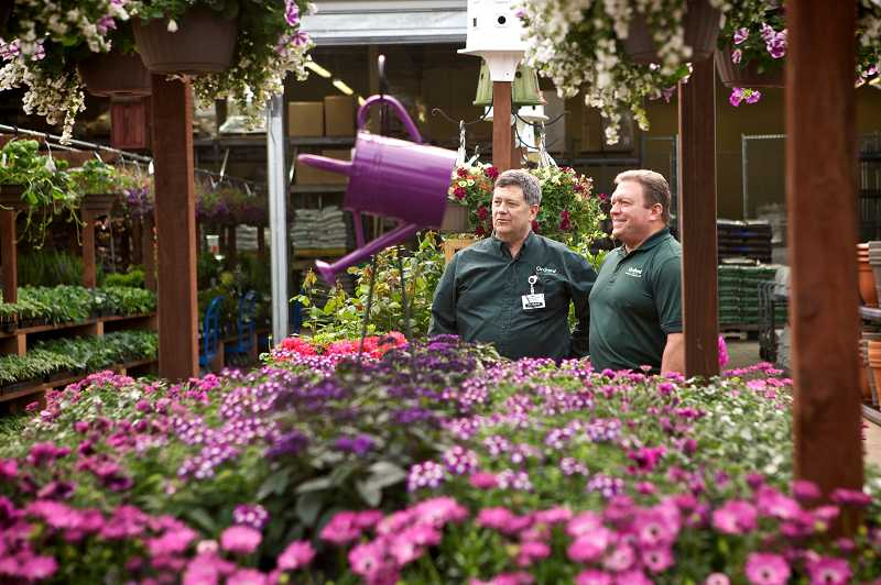 by: TIMES PHOTO: JAIME VALDEZ - Mike Wickstrom and Joe Kelley, store manager and regional operations manager, respectively, for Orchard Supply Hardware, show off the nursery at the store's Barnes Road location, which will open on Saturday, April 27.