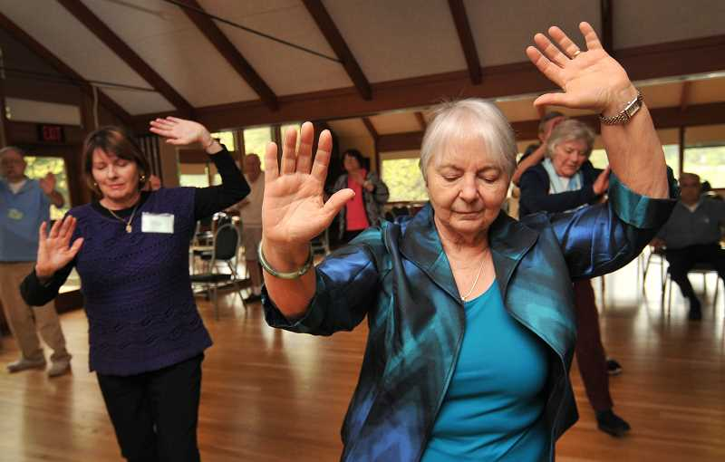 by: REVIEW, TIDINGS PHOTO: VERN UYETAKE - Tai chi instructor Joyce Spreyer leads a group of seniors through a routine.