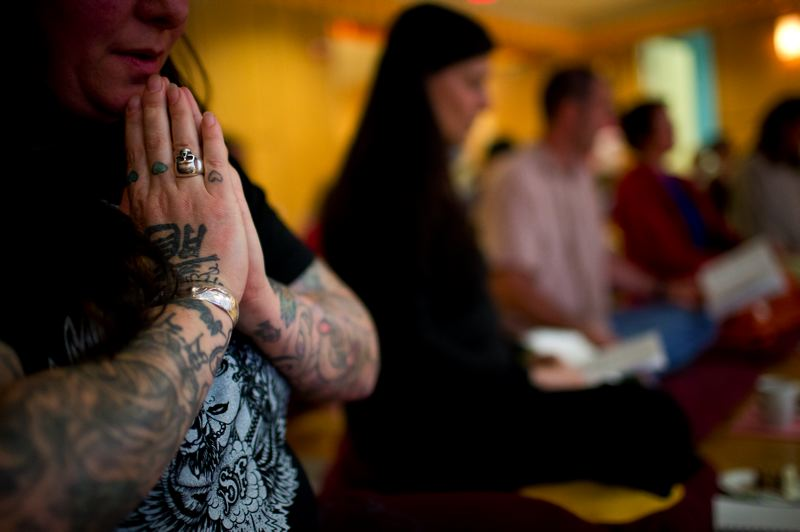 by: TRIBUNE PHOTO: CHRISTOPHER ONSTOTT - Buddhist services draw a mix of ages, including student Mikki Columus.