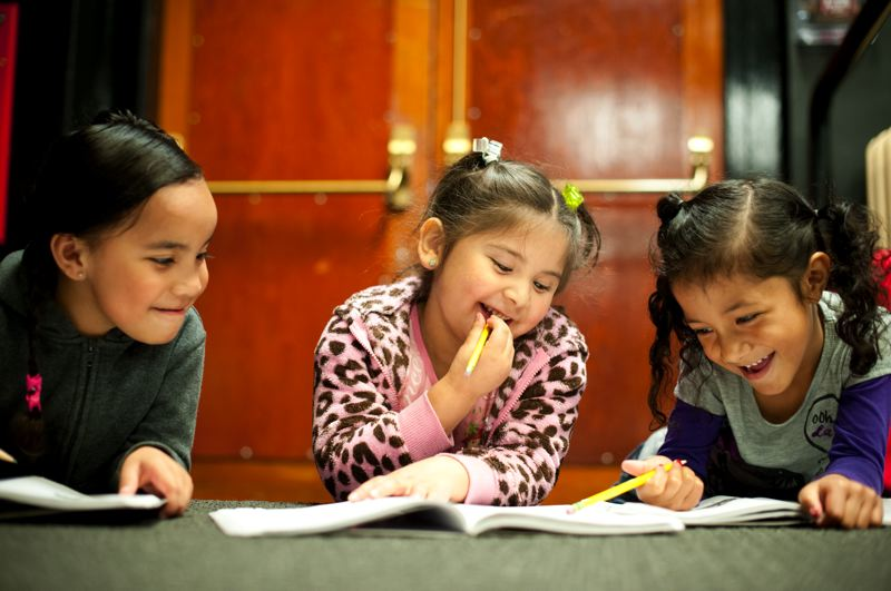 by: TRIBUNE PHOTO: CHRISTOPHER ONSTOTT - Pre-kindergarten students practice their writing in class one morning this week at Ockley Green. The school has a new focus on literacy, but will close this year as it merges with Chief Joseph School.