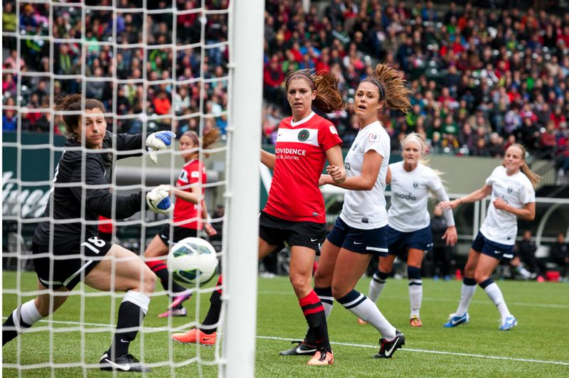by: TRIBUNE PHOTO: CHRISTOPHER ONSTOTT - Marian Dougherty scores the first home goal in Portland Thorns' FC history, as the club topped the Seattle Reign FC 2-1 at Jeld-Wen Field.