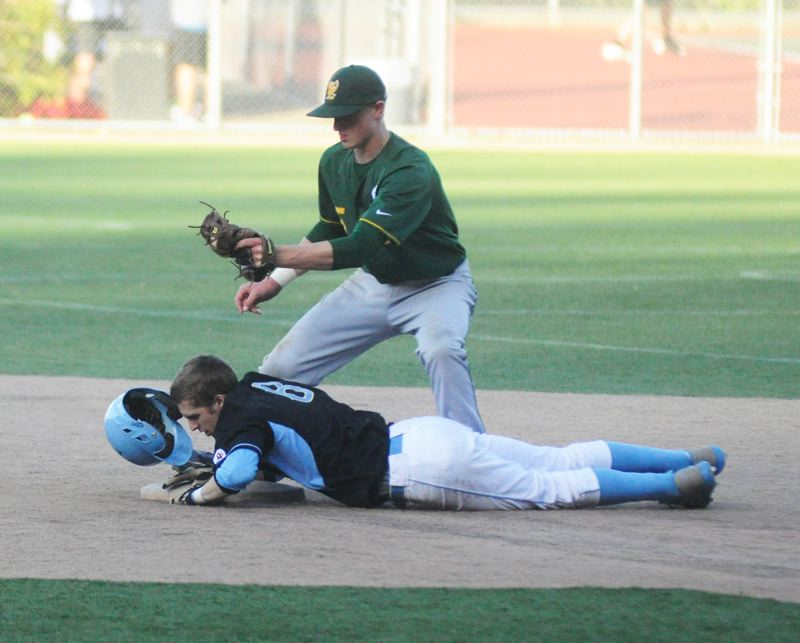 by: MATTHEW SHERMAN - West Linn shortstop Karsen Lindell tags on a Lakeridge runner trying to steal second base in Monday's game against the Pacers.