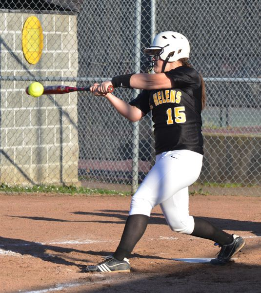 by: JOHN BREWINGTON - St. Helens' Taylor Leal knows how to put the bat on the ball. She banged out a hit here during Tuesday's home game with Parkrose.
