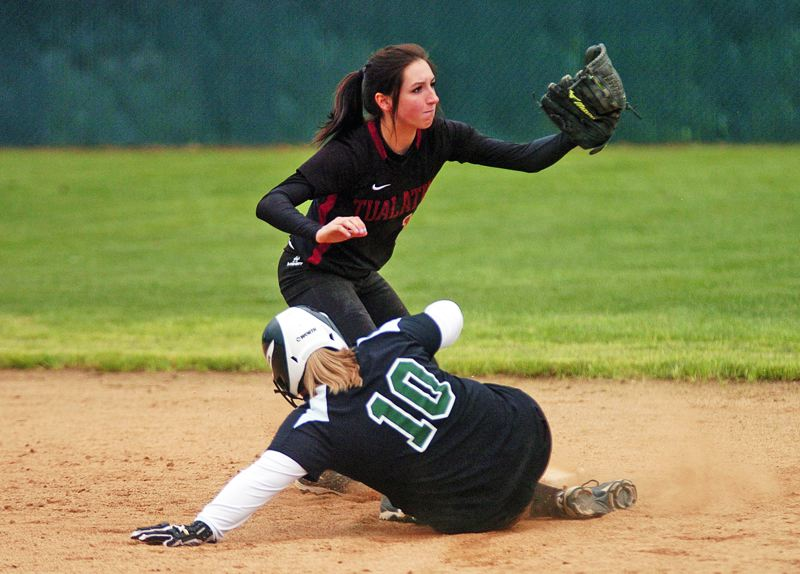 by: DAN BROOD - CAUGHT STEALING -- Tualatin High School sophomore shortstop Joslyn Gastiaburu holds up the ball after she tagged out Tigard's Lyssa Rabideau on a stolen base attempt in last week's game.