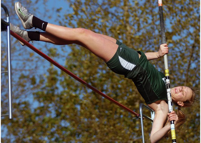 by: DAN BROOD - TOP VAULTER -- Tigard sophomore Liz Prouty (shown here at meet earlier this season), who holds the top pole vault mark in the state, helped the Tiger girls beat McMinnville.