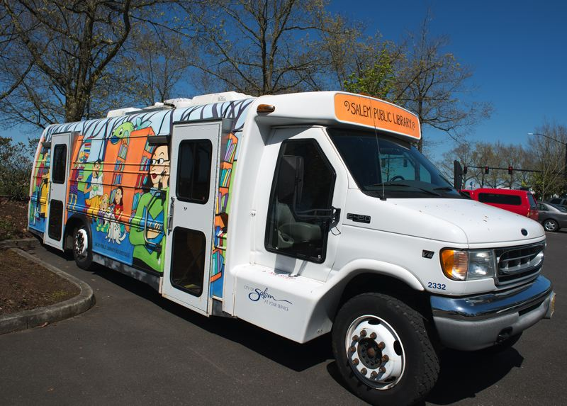 by: HILLSBORO TRIBUNE PHOTO: CHASE ALLGOOD - This colorful bookmobile will be on loan from the Salem Public Library while the Shute Park library is under construction.