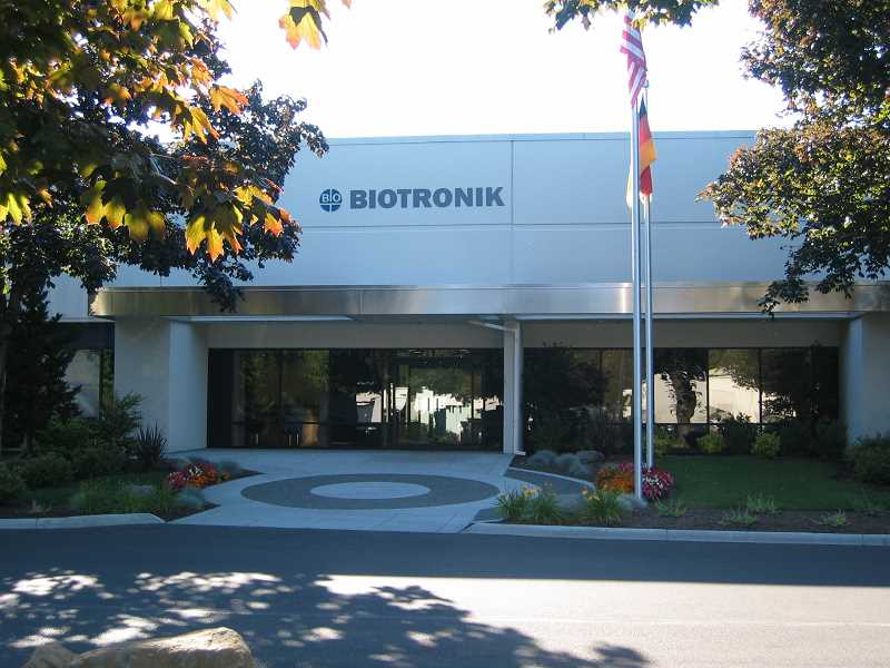 by: SUBMITTED PHOTO - Above, it is somewhat difficult to see Biotronik's building in Lake Oswego. But you cannot hide its eminence in the field of medical technology for heart care.  Right, testing, testing and more testing is the key to Biotronik's success. The company will be observing its golden anniversary this year.