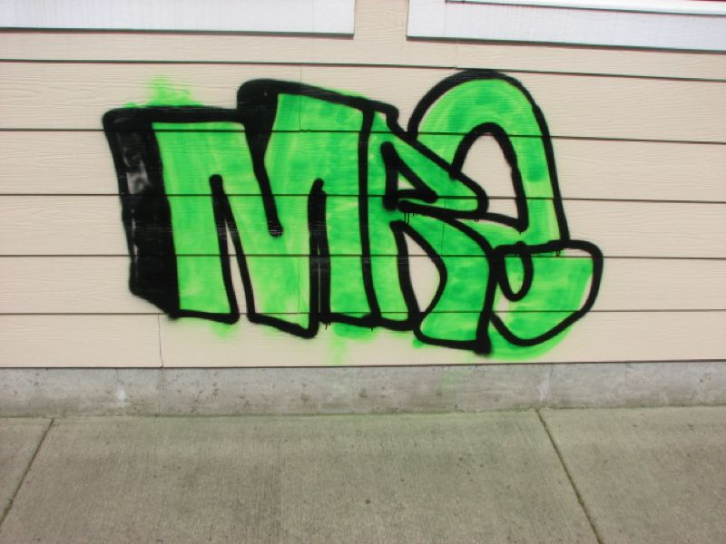 by: SUBMITTED PHOTO - A neon green tag at a Scappoose building took three coats of primer and two coats of paint to cover up, said the owner. Scappoose police have arrested a 16-year-old suspect in connection with graffiti reported around town.