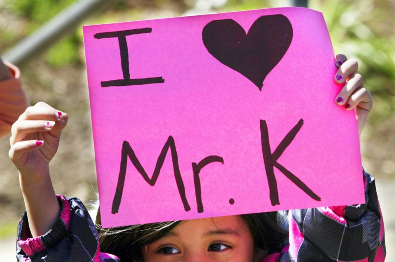 by: OUTLOOK PHOTO: JIM CLARK  - A North Gresham Elementary School student holds up a  I Love Mr. K sign at the end of the school day.