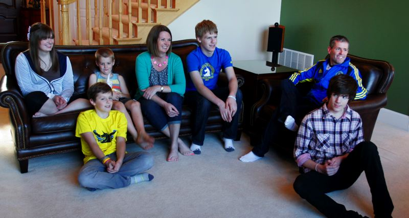 by: OUTLOOK PHOTO: JIM CLARK - Mark and Jill Dorrough returned from Boston Sunday, April 21, grateful to be home with their children. From left are Aubrey, 17, Noah, 11 (seated on floor), Zachary, 6, Jill, Joel, 13, Dorrough and Jacob, 16. Oldest son Abram, 19, is away at college.