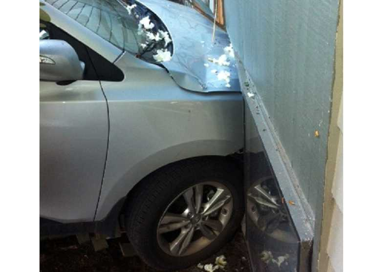 by: COURTESY OF TUALATIN VALLEY FIRE & RESCUE - CALL A TOW TRUCK - The front of this car is embedded several feet into a bedroom wall of this King City apartment, and the resulting burst pipes caused damage to the interior until the water could be turned off.